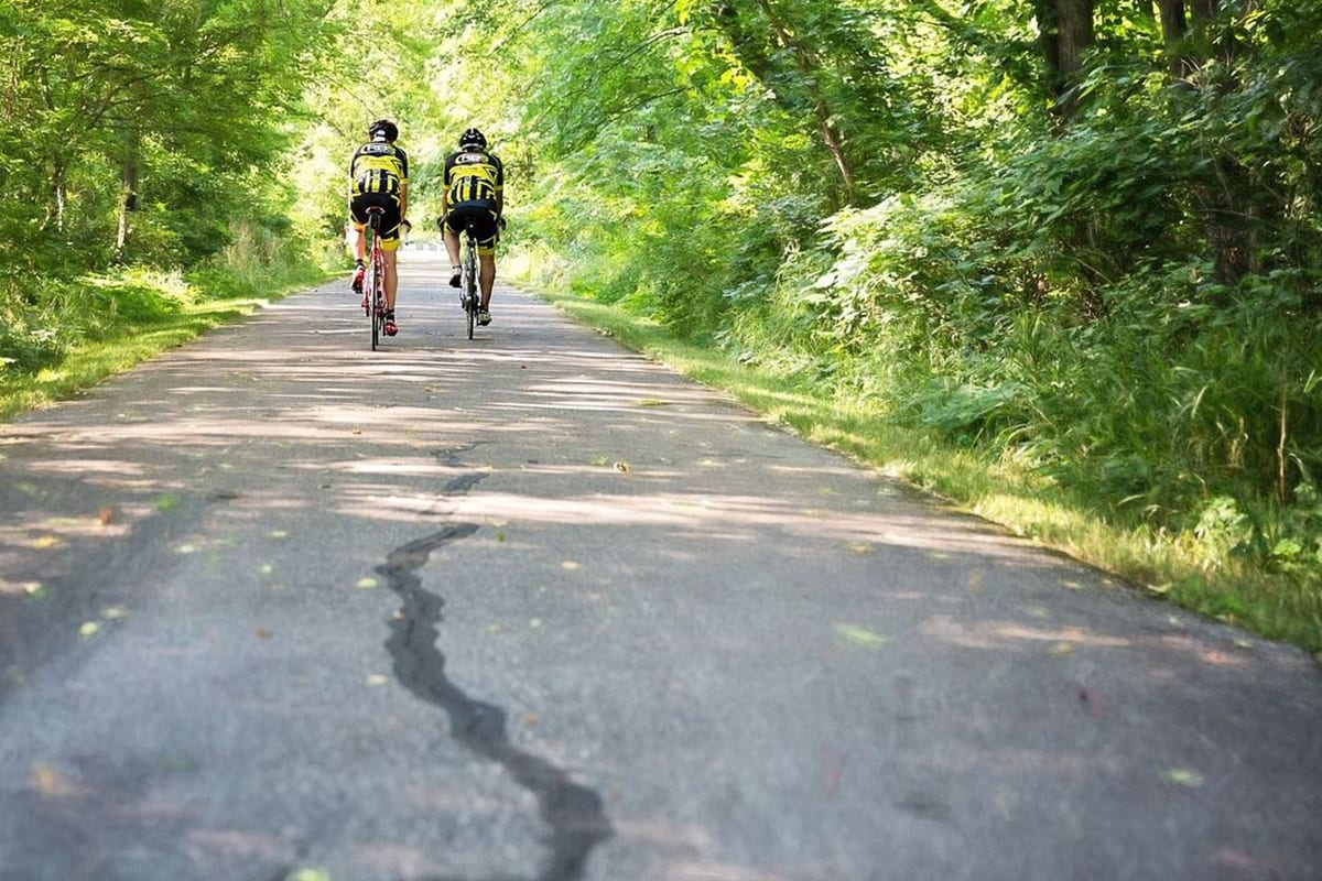two bikers on the flat trail